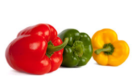 Red green and yellow pepper on a white background Royalty Free Stock Photos