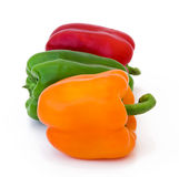 Red green and yellow peppers. Isolated Royalty Free Stock Images