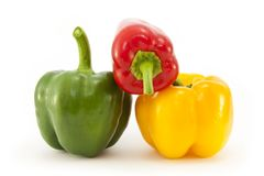 Red, Green and Yellow peppers Stock Images