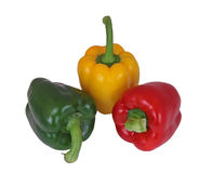 Red, green and yellow peppers. On a plain white background Royalty Free Stock Photos