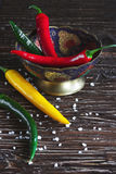 Red, green and yellow peppers on dark Stock Photo