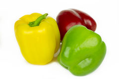 Red, green and yellow peppers Stock Image