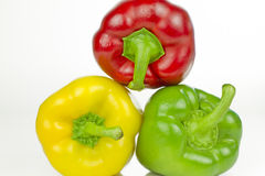 Red, green and yellow peppers Royalty Free Stock Photography