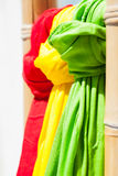 Red, green and yellow scarves. Royalty Free Stock Photography