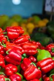Red, green and yellow sweet bell peppers natural background. Stock Photography