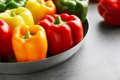 Red, green and yellow sweet bell peppers on table,. Close up stock photo