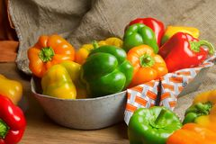 Red, green and yellow sweet bell peppers on table, Royalty Free Stock Image