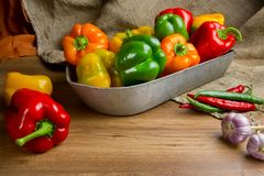 Red, green and yellow sweet bell peppers on table, Royalty Free Stock Photo