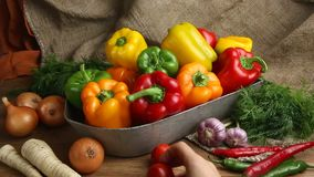 Red, green and yellow sweet bell peppers on table, stock video footage