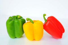 Red Green Yellow sweet pepper. Paprika on white background royalty free stock photo