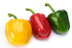 Red green and yellow Sweet peppers on white background Royalty Free Stock Images
