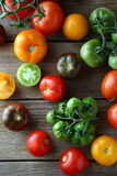 Red, green and yellow tomatoes on boards. Top view Stock Image