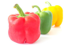 Red ,green and yellowvpeppers on white background Royalty Free Stock Image