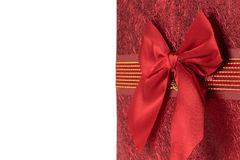 Red greeting card with bow on the white background Royalty Free Stock Photos