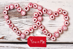 Red greeting card and candies. Sweets in shape of heart. Way to confess in love Stock Photo