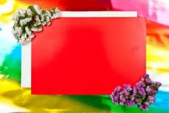 Red greeting card with flowers Royalty Free Stock Photography