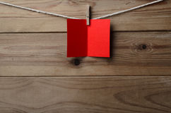 Red Greetings Card Pegged to String on Wood Plank Background Stock Photos