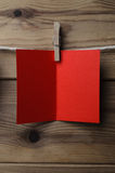 Red Greetings Card Pegged to String on Wood Planking Royalty Free Stock Photo