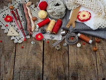 Red and grey accessories for needlework on wooden background. Knitting, embroidery, sewing. Small business. Income from hobby. Stock Image