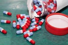 Red grey Blue pills Stock Photos