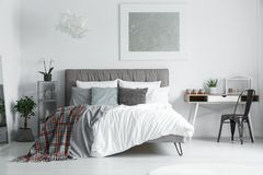 Checkered bedsheets lying on bed Royalty Free Stock Photo