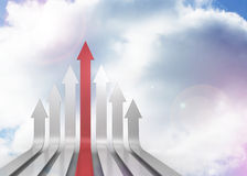 Red and grey curved arrows pointing up. Against sky Royalty Free Stock Images