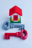 Red and grey house key Royalty Free Stock Photography