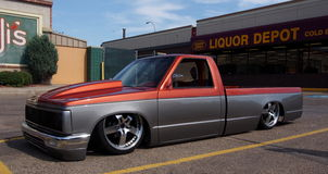 Red And Grey Lowrider Truck With Hydraulics Stock Photo