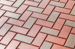 Red and grey paving stones as background Stock Image