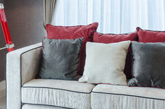 Red and grey pillows on luxury sofa in living room Royalty Free Stock Images