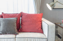 Red and grey pillows on luxury sofa in living room Royalty Free Stock Image
