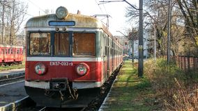 Old electric multiple unit En57 operated by Przewozy Regionalne in Cieszyn station in Poland. Red, grey and white livery of old local and regional transport stock image