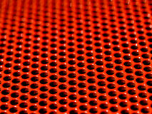 Red grid. Macro picture of a red metallic grid Royalty Free Stock Photo