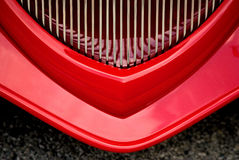 Red grill classic car. The grill of a red classic and antique automobile Royalty Free Stock Images