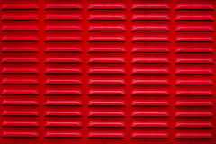 Red grille texture. Abstract mesh. . Red grille textureRed color metal surface with ventilation holes. Abstract background and texture for design Stock Photos