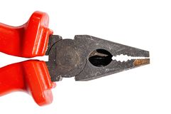 Red grip steel engineer equipment pliers with clipping path. For work construction Stock Image