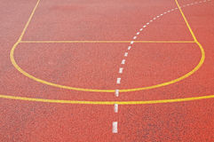 Red ground as a background. Red ground on a sport stadium with yellow lines as an abstract background Royalty Free Stock Image