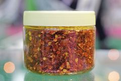 Red Ground chilli in bottle ;. Close up stock photography