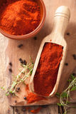 Red ground paprika spice in wooden scoop and bowl Royalty Free Stock Photography