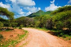 Free Red Ground Road And Savanna. Tsavo West, Kenya, Africa Royalty Free Stock Image - 29601616
