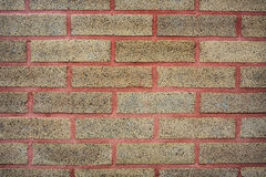Red Grout and Brick Wall Background. Tan brick wall with red grout and mortar Royalty Free Stock Images
