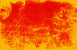 Red grunge. Red and orange grunge background with scratches and scrolls Royalty Free Stock Photos