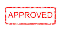 Red Grunge Approved. Red grunge style rubber stamp design with the word approved within a border with rounded corners, on a plain white background Stock Photo