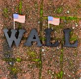 Red grunge brick with metal letters and United States flags for border wall protection concept. Red grunge brick stone with metal letters and United States flag royalty free stock photography