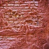 Red grunge brick wall. With distorted and cracked plaster Stock Photography
