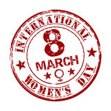 Red grunge rubber stamp with the text International Womens Day written inside. March 8. Vector illustration Stock Images