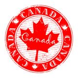 Red grunge stamp. With name of Canada written inside the stamp Royalty Free Stock Images