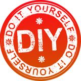 Red grunge style rubber stamp DIY. Do it yourself. Royalty Free Stock Image