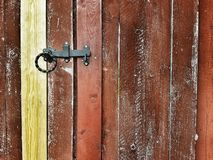 Red grunge worn door with a doorknob. Red grunge worn door doorknob background backdrop backgrounds scratched  wall building architechture home copy space text royalty free stock image