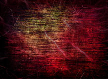 Red grungy scratched multicolored texture as abstract background Royalty Free Stock Image